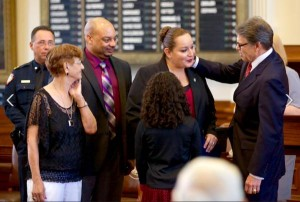 Ann Carrizales and family. Ann is receiving the Star of Texas Award from Texas Governor Rick Perry